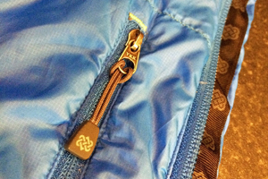 Sherpa Dingboche Jacket endless knot logo